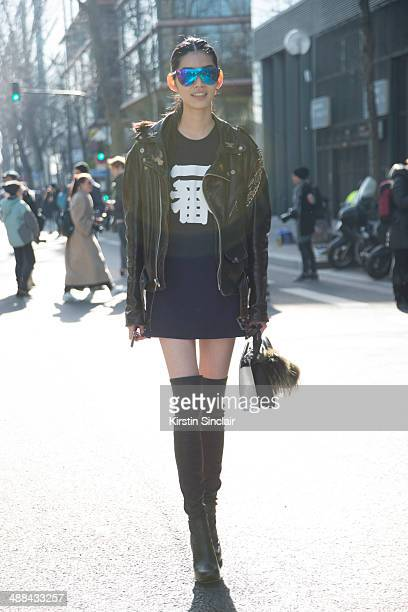 Model Ming Xi wears a vintage Harley Davidson jacket Fendi Monster Pom Pom and bag and Phillip Lim sunglasses on day 6 of Paris Collections Women on...