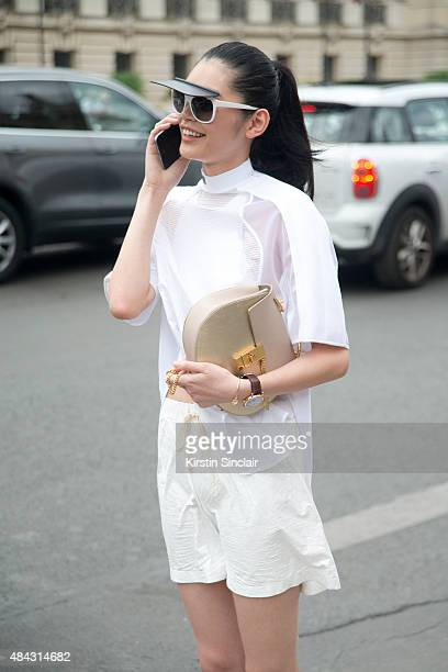 Model Ming Xi wears an Alexander Wang top and shorts with a Chloe bag on day 3 of Paris Fashion Week Haute Couture Autumn/Winter 2015 on July 7 2015...