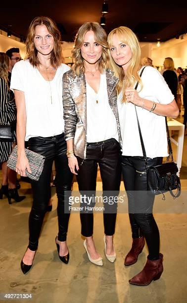 model Mini Anzem Designer Anine Bing and actress Izabella Scorupco attend the Anine Bing Celebrates Los Angeles Flagship Opening at Anine Bing...