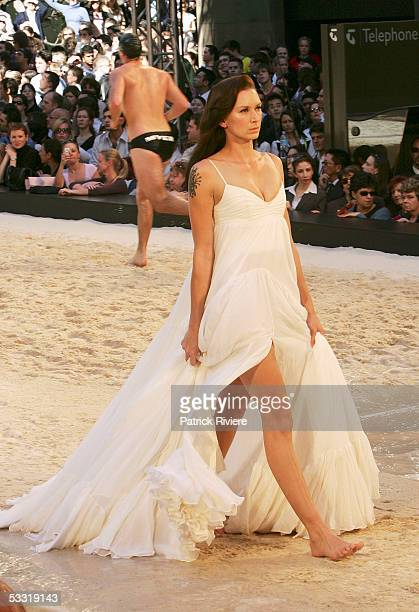 Model Mink walks on a summer beach film catwalk set in the middle of the city in Martin Place to showcase the Myer Spring/Summer 06 collections on...