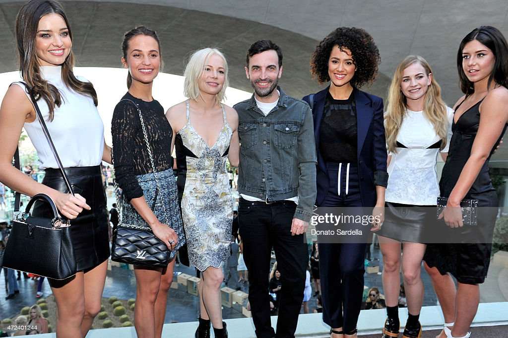 Model Miranda Kerr actresses Alicia Vikander and Michelle Williams, designer Nicolas Ghesquiere and actresses Nathalie Emmanuel, Britt Robertson, and Adèle Exarchopoulos backstage at the Louis Vuitton Cruise 2016 Resort Collection shown at a private residence on May 6, 2015 in Palm Springs, California.