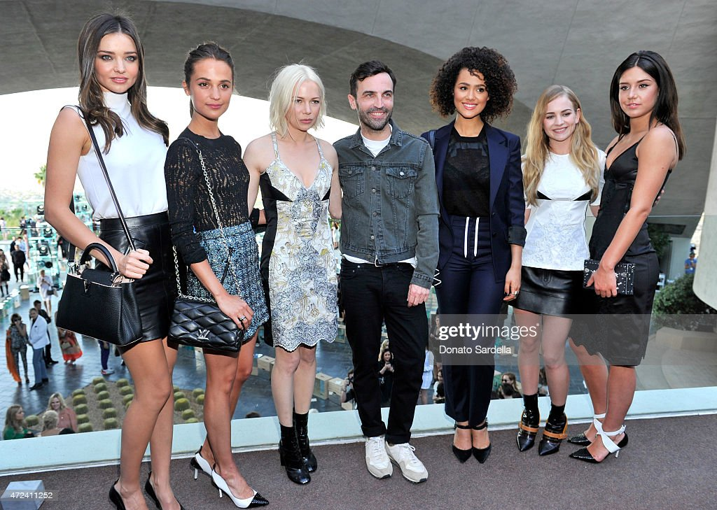 Model Miranda Kerr actresses Alicia Vikander and Michelle Williams, designer Nicolas Ghesquiere and actresses Nathalie Emmanuel, Britt Robertson, and Adele Exarchopoulos backstage at the Louis Vuitton Cruise 2016 Resort Collection shown at a private residence on May 6, 2015 in Palm Springs, California.