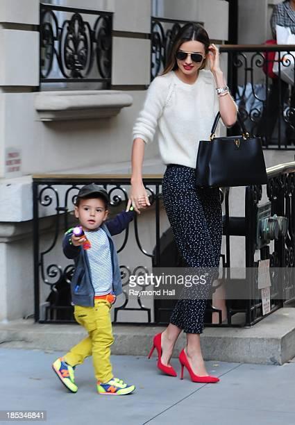 Model Miranda Kerr and Flynn Bloom are seen in Soho on October 18, 2013 in New York City.