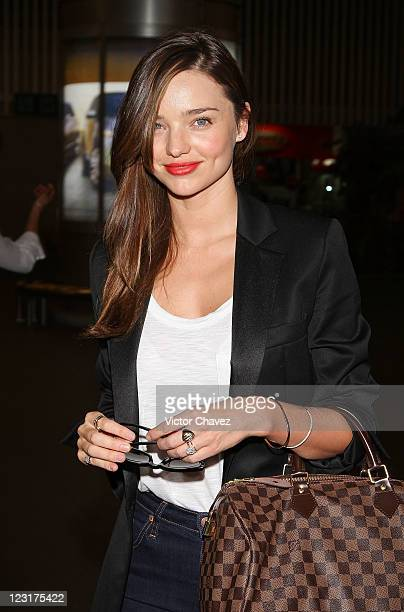 Model Miranda Kerr arrives at the Mexico City International Airport on August 31 2011 in Mexico City Mexico