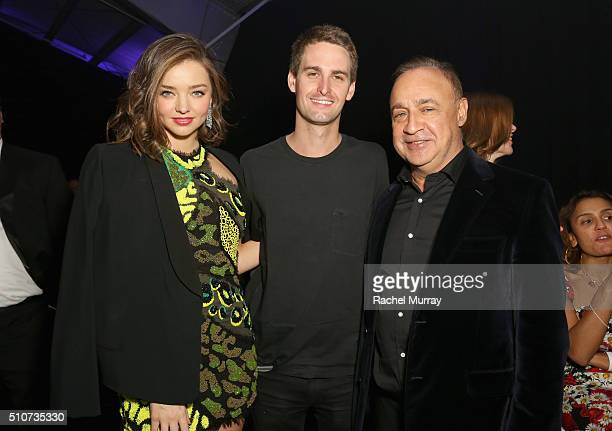 Model Miranda Kerr CoFounder CEO of SnapChat Evan Spiegel and Len Blavatnik Chairman of Access Industries and owner of Warner Music Group attend...