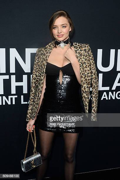 Model Miranda Kerr in Saint Laurent by Hedi Slimane arrives at the Saint Laurent show at the Hollywood Palladium on February 10 2016 in Los Angeles...