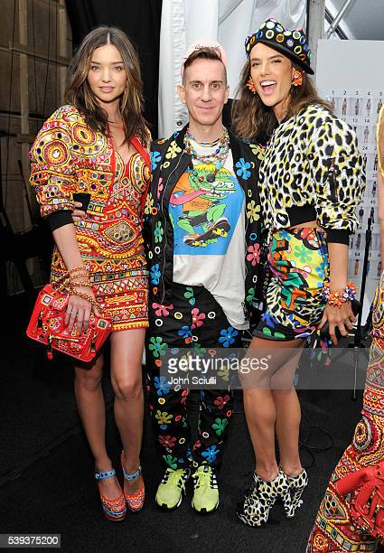 Model Miranda Kerr Moschino Creative Director Jeremy Scott and model Alessandra Ambrosio pose backstage at the Moschino Spring/Summer 17 Menswear and...