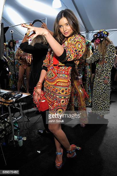 Model Miranda Kerr poses backstage at the Moschino Spring/Summer 17 Menswear and Women's Resort Collection during MADE LA at LA LIVE Event Deck on...