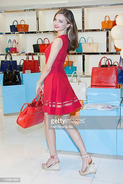 Model Miranda Kerr poses for media during a promotional event for the 'Samantha Thavasa' at Lotte Departmemt Store on June 12, 2013 in Seoul, South...