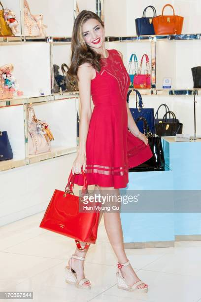 Model Miranda Kerr poses for media during a promotional event for the 'Samantha Thavasa' at Lotte Departmemt Store on June 12 2013 in Seoul South...