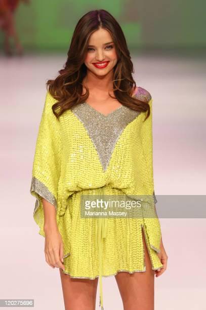 Model Miranda Kerr showcases designs by Camilla on the catwalk at the David Jones Spring/Summer 2011 season launch at the Royal Hall of Industries...