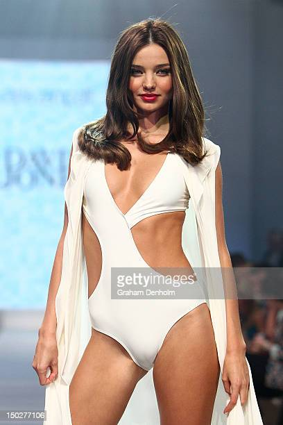 Model Miranda Kerr showcases designs by Carla Zampatti during the David Jones S/S 2012/13 Season Launch at David Jones Castlereagh Street on August...