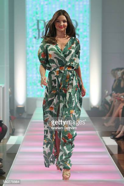 Model Miranda Kerr showcases designs by Lisa Ho during the David Jones S/S 2012/13 Season Launch at David Jones Castlereagh Street on August 14 2012...