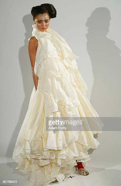 A model walks down the runway wearing designs from the Akira Collection Show during the Mercedes Australian Fashion Week Launch at Sydney University...