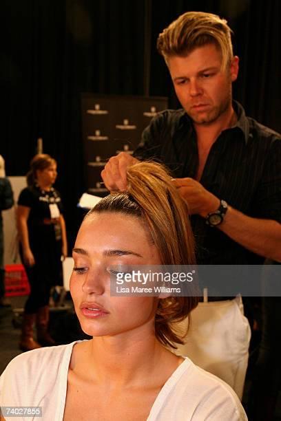 Model Miranda Kerr wears designs by Alex Perry prepare backstage ahead of his catwalk show on day one of Rosemount Australian Fashion Week...