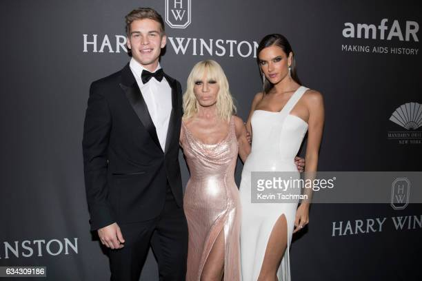 Model Mitchell Slaggert Donatella Versace and Alessandra Ambrosio attend the 19th Annual amfAR New York Gala at Cipriani Wall Street on February 8...