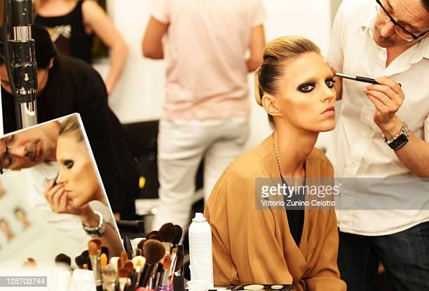 Model Model Anja Rubik prepares backstage at the Gucci Spring/Summer 2012 fashion show as part Milan Womenswear Fashion Week on September 21, 2011 in...
