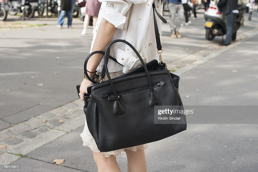 8a64293a97a7 Model Model Sung Hee wears a Prada bag and all else is vintage on ...