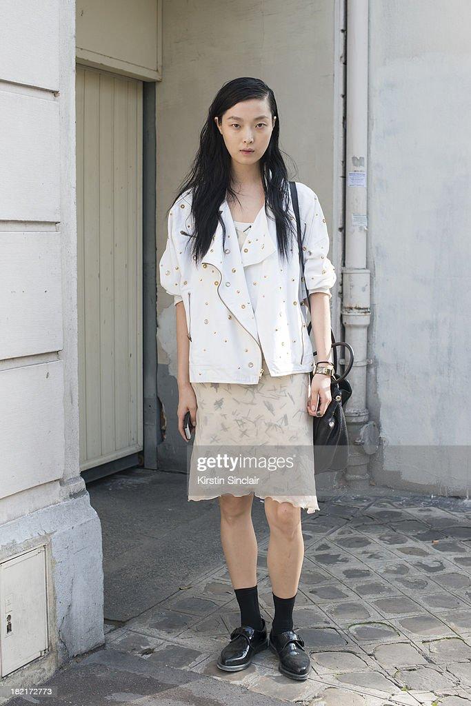 fd932d6145cb Model Model Sung Hee wears Doc Martins shoes, Prada bag and all else ...