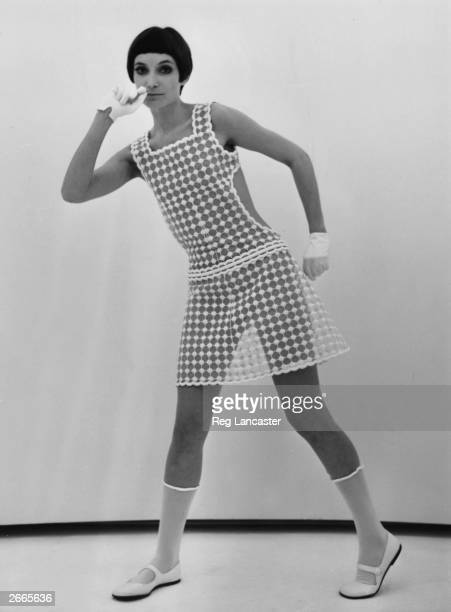 A model modelling a diaphanous pinaforestyle day dress by Courreges