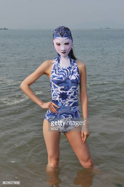 A model models the seventh version of facekini on a beach on June 28 2017 in Qingdao Shandong Province of China The seventh version of facekini...