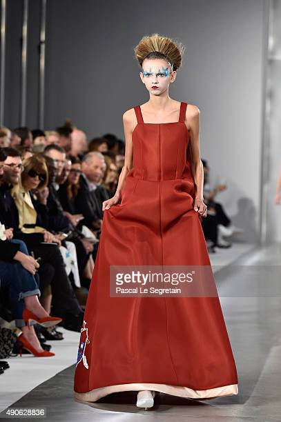 Model Molly Bair walks the runway during the Maison Margiela show as part of the Paris Fashion Week Womenswear Spring/Summer 2016 on September 30,...