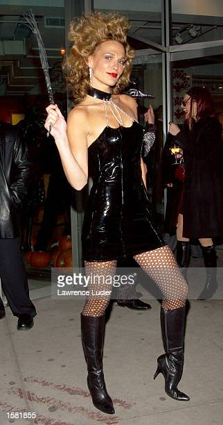 Model Molly Sims arrives at the DKNY store's Halloween party October 31 2002 in New York City New York