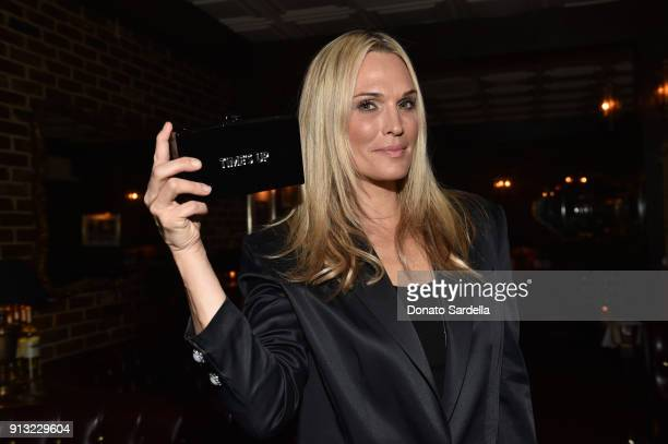 Model Molly Sims attends Edie Parker's LA Dinner Party at La Dolce Vita on February 1 2018 in Beverly Hills California