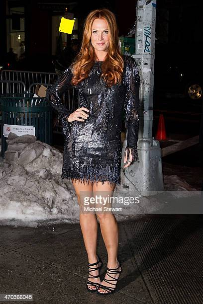 Model Molly Sims attends Sports Illustrated Swimsuit 50th Anniversary Party at the Swimsuit Beach House on February 18 2014 in New York City