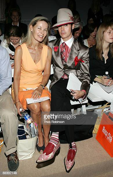Model Mona Arnold and Writer Patrick McDonald pose in the front row at the Atil Kutoglu Spring 2006 fashion show during Olympus Fashion Week at...