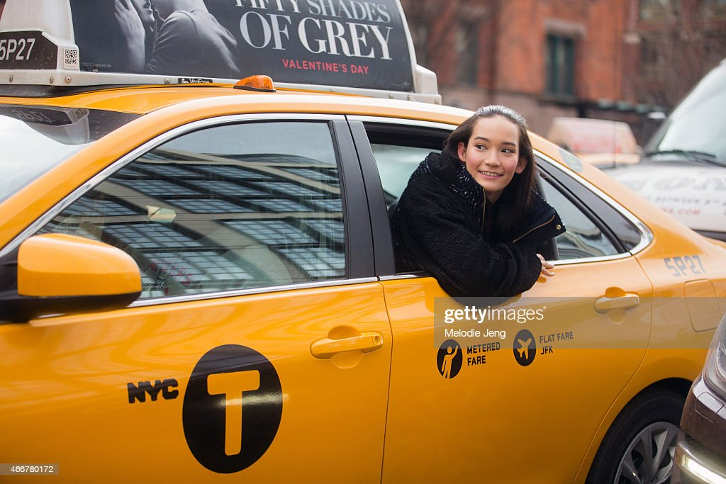 Model Mona Matsuoka exits a show by taxi in a Babyghost top at Streets of Manhattan on February 12, 2015 in New York City.