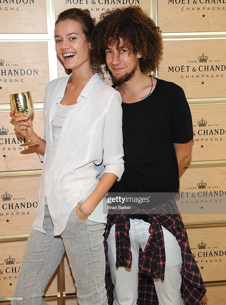 Model Monika 'Jac' Jagaciak and Joaciam attend The Moet & Chandon Suite at USTA Billie Jean King National Tennis Center on August 29, 2013 in New York City.