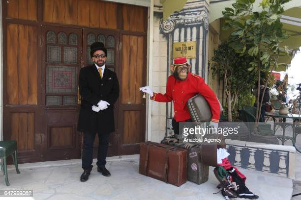 A model monkey carrying bags is seen outside a hotel named 'The Walled Off' in Bethlehem in the southern West Bank which is surrounded on all four...