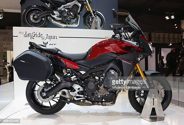MT model MT09 Tracer is displayed at YAMAHA booth during the EICMA 2014 72nd International Motorcycle Exhibition at Fiera Milano on November 4 2014...