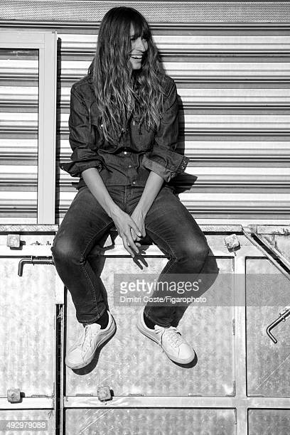 Model music producer and actress Caroline de Maigret is photographed for Madame Figaro on July 9 2015 in Paris France Shirt jeans socks sneakers...