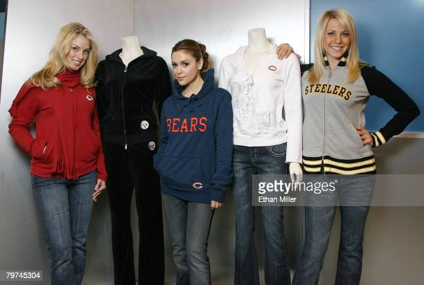 Model Nadine Braun actress Alyssa Milano and model Katie Osborne show new creations with National Football League team logos from Milano's fashion...