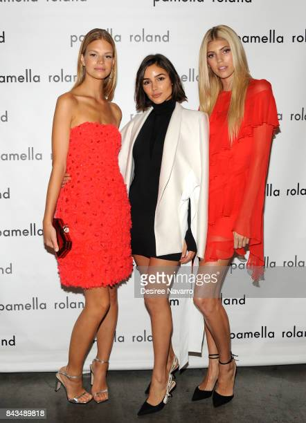 Model Nadine Leopold actress Olivia Culpo and model Devon Windsor pose backstage for the Pamella Roland Spring 2018 Collection Show during New York...