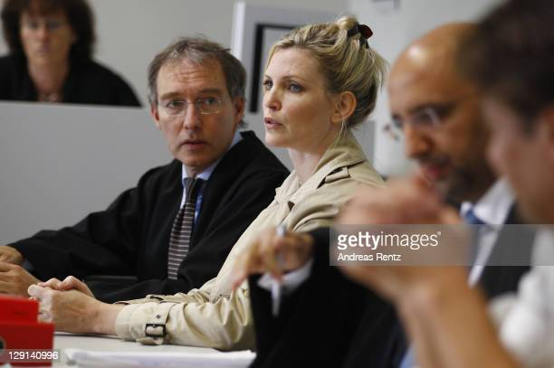Model Nadja Auermann arrives for another day in court with her lawyer to face charges of income tax evasion at the Amtsgericht Tiergarten on October...