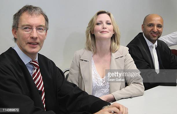 Model Nadja Auermann arrives in court with lawyers to face charges of income tax evasion on May 19 2011 in Berlin Germany German tax authorities...