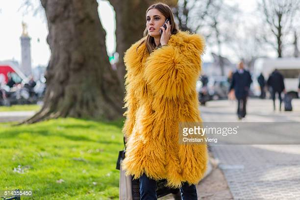 Model Nadja Bender wearing a yellow fur coat outside Chanel during the Paris Fashion Week Womenswear Fall/Winter 2016/2017 on March 8 2016 in Paris...