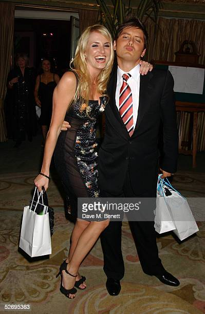 Model Nancy Sorrell and TV presenter Brian Dowling attend the UK FiFi Awards at The Dorchester on April 25 2005 in London England The awards mirror...