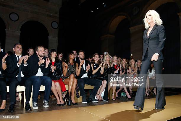 Model Naomi Campbell actors Bradley Cooper and Jennifer Garner applause Donatella Versace at the end of the Atelier Versace Haute Couture Fall/Winter...