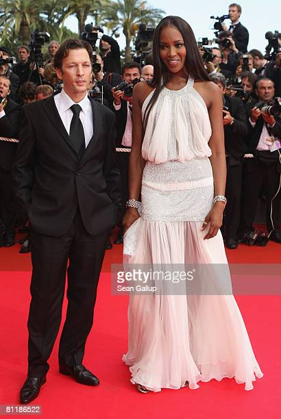 Model Naomi Campbell and an unidentified guest arrive at the 'Che' Premiere at the Palais des Festivals during the 61st International Cannes Film...