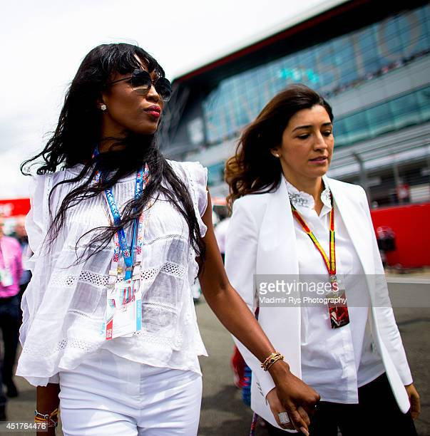 Model Naomi Campbell and Bernie Ecclestone's wife Fabiana Flosi are pictured on the grid prior to the British Formula One Grand Prix at Silverstone...