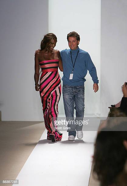 Model Naomi Campbell and designer Atil Kutoglu walk the runway at the Atil Kutoglu Spring 2006 fashion show during Olympus Fashion Week at Bryant...