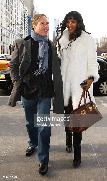 Model Naomi Campbell and Designer Tommy Hilfiger walk outside Cirpiani on December 21, 2004 in New York City.
