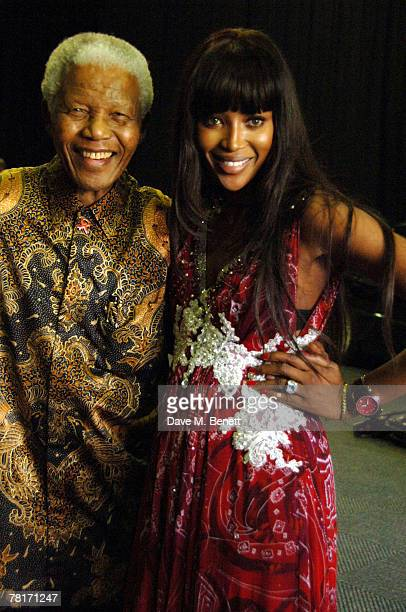 Model Naomi Campbell and Nelson Mandela attend the Nelson Mandela Fundraising Lunch at the Gallagher Estate prior to the 46664 World Aids Day Concert...