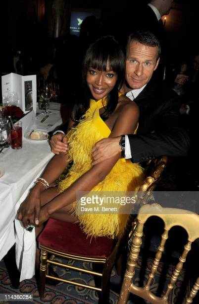 Model Naomi Campbell and Vladimir Doronin attend the Cinema For Peace inaugural Cannes dinner honoring Sean Penn for his charity work in Haiti and...