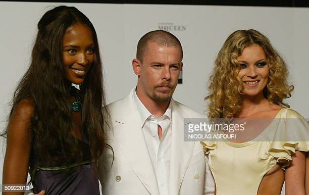 Model Naomi Campbell, designer Alexander McQueen and model Kate Moss arrive for the 'Black' charity auction and fashion show in London 03 June, 2004....