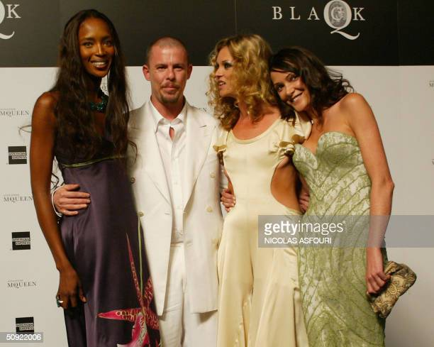 Model Naomi Campbell designer Alexander McQueen model Kate Moss and Annabelle Neilson arrive for the 'Black' charity auction and fashion show in...